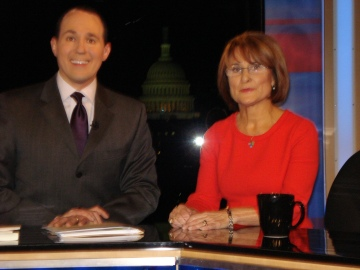"Liz Yore with Raymond Arroyo, host of EWTN, while appearing on ""World Over"""